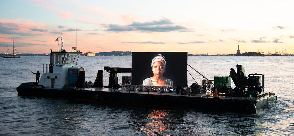Night Watch [Norris at Sunset], 20' wide LED screen on barge, Hudson River, 2019