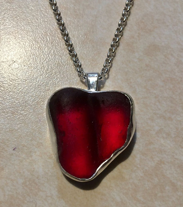 Sterling silver red sea glass heart necklace.