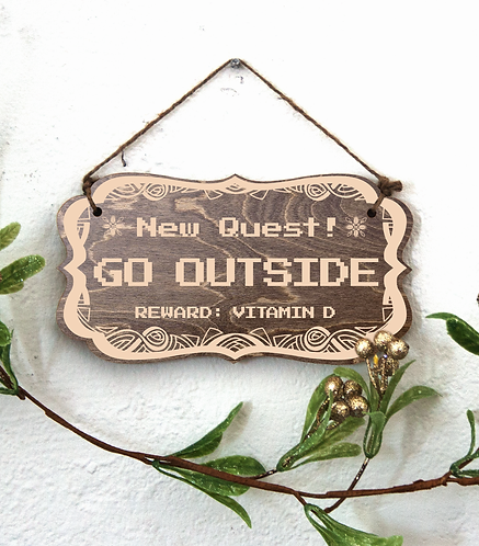 """""""New Quest: Go Outside"""" sign"""