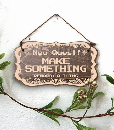 """New Quest: Make Something"" sign"