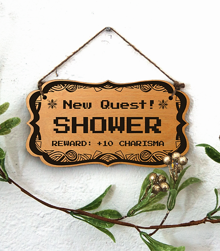 """""""New Quest: Shower"""" sign"""