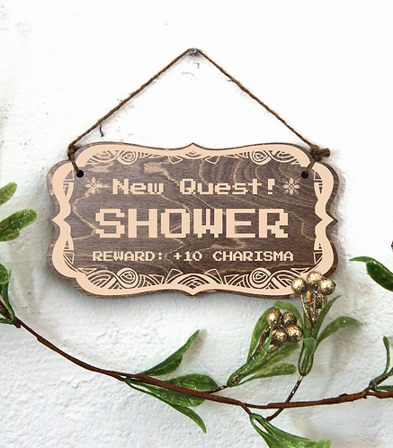 """New Quest: Shower"" sign"