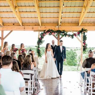 wedding couple go down the aisle