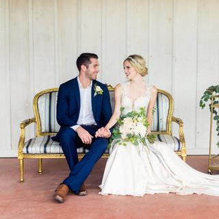 bride and groom sit on pavilion