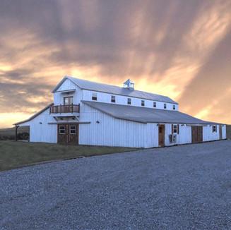 sunrise at the big white barn