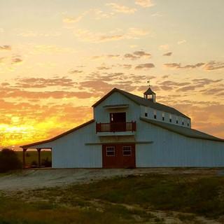 big white barn sunrise