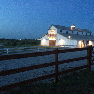 the big white barn at dusk