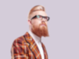 Man in Red Suit and norther quarter styled beard and glasses