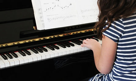 Learner playing piano