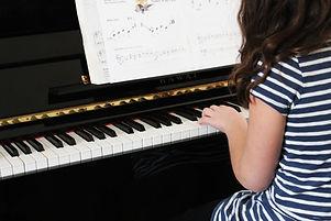 Girl Playing Beginner Piano