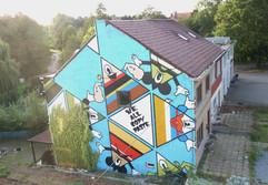 Street art muurschildering Genk