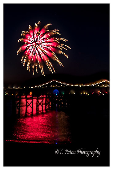 Abstract fireworks over bridge
