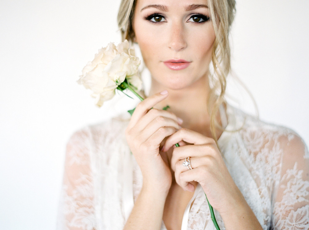 Close-up of a bride holding a flower
