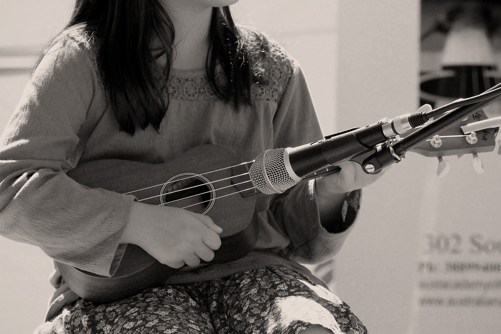 Musical student playing the uke