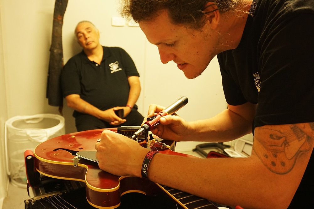 working on a guitar on new years eve