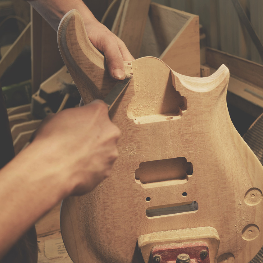 Shaping and sanding guitars