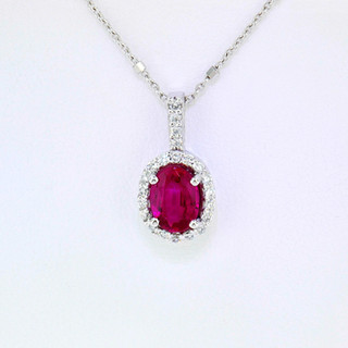 14k white gold pendant .23ct total weight diamond, .94ct total weight ruby center stone
