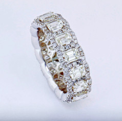 18k white gold, 4.82ct total weight, emerald cut and round diamonds, prong set with micro pavé halo