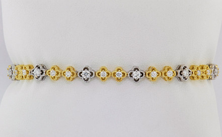 14k two-tone, yellow and white 1.55ct total weight diamond clover tennis bracelet