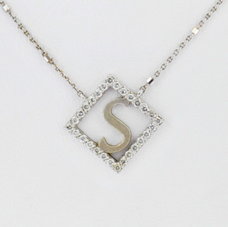 14k white gold .28ct total weight, diamond initial pendant