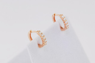 14k rose gold, .38ct total weight common prong earrings