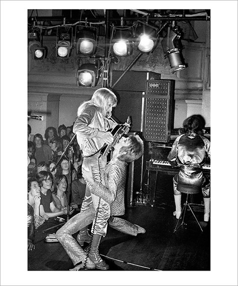 """David Bowie and Mick Ronson, Guitar Fellatio 1972 © Mick Rock, 1972  11""""x14"""" $1,500 USD (limited edition of 90)  16""""x20"""" $2,500 USD (limited edition of 90)  20""""x24"""" $3,000 USD (limited edition of 50)  24""""x30"""" $4,700 USD (limited edition of 35)  30""""x40"""" $8,500 USD (limited edition of 25)  40""""x60"""" $15,000 USD (limited edition of 10)"""
