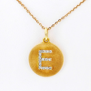 14k yellow gold .15ct total weight, diamond initial pendant
