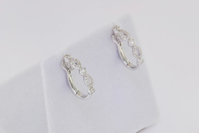 18k white gold, .29ct total weight round, micro pavé and bezel set earrings.