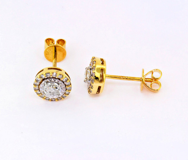 14k two-tone, white and yellow gold .72ct total weight diamond stud earrings