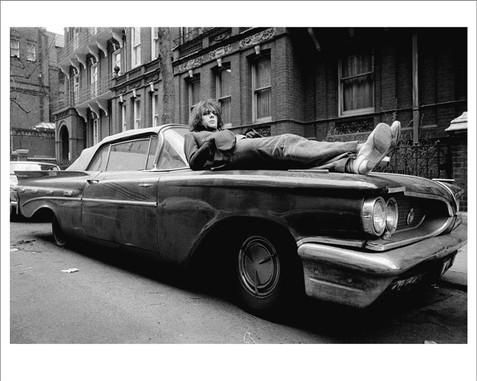 """Syd Barrett On Car London 1969 © Mick Rock  11""""x14"""" $1,200 USD (limited edition of 90) 16""""x20"""" $2,000 USD (limited edition of 90) 20""""x24"""" $2,500 USD (limited edition of 50) 24""""x30"""" $4,000 USD (limited edition of 35) 30""""x40"""" $7,000 USD (limited edition of 25) 40""""x60"""" $12,000 USD (limited edition of 10)"""