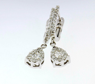 14k white gold .78ct total weight, diamond earrings