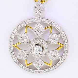 18k two-tone, yellow and white gold 1.03ct total weight diamond pendant