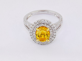 18k white gold .85ct total weight diamond ring with yellow sapphire center stone
