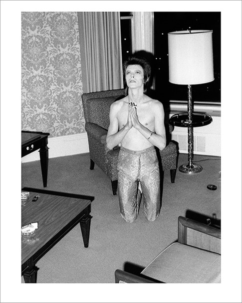 """Bowie Praying On Knees Chicago 1972 © Mick Rock  11""""x14"""" $1,500 USD (limited edition of 90)  16""""x20"""" $2,500 USD (limited edition of 90)  20""""x24"""" $3,000 USD (limited edition of 50)  24""""x30"""" $4,700 USD (limited edition of 35)  30""""x40"""" $8,500 USD (limited edition of 25)  40""""x60"""" $15,000 USD (limited edition of 10)"""