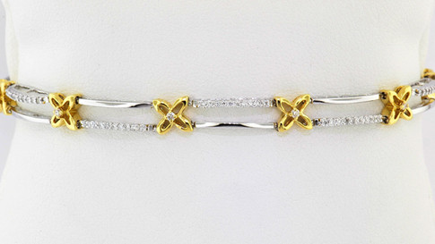 18k two tone, white and yellow gold .60ct total weight diamond bracelet