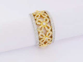 18k two-tone, white and yellow gold, .70ct total weight, micro pavé and bezel set, round diamonds