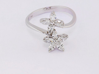 18k white gold, 1.33ct total weight, marquis shape diamonds, prong set, flower ring