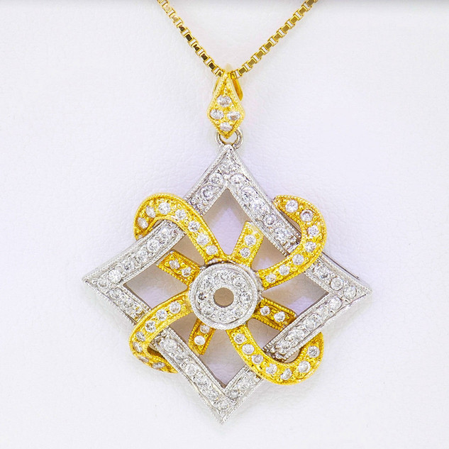 18k two-tone, white and yellow gold .50ct total weight diamond pendant