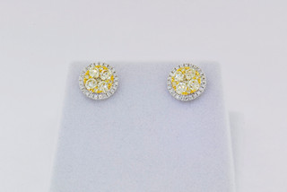 18k two-tone white and yellow gold, .24ct white round, 1.11ct yellow round, micro pavé and invisible set diamond earrings.