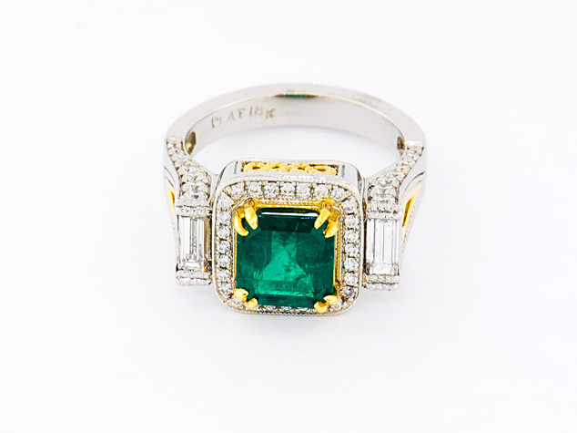 Platinum and 18k yellow gold .48ct total weight diamond setting, .65ct total weight emerald center stone
