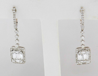 18k white gold 1.12ct total weight, diamond earrings