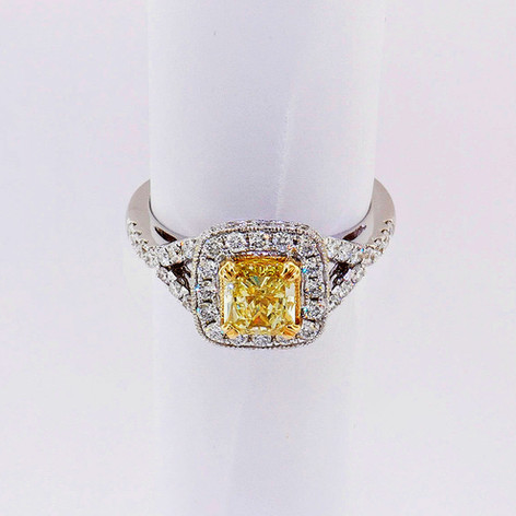 14k white gold, .72ct diamond setting with 1.11ct fancy yellow radiant cut center