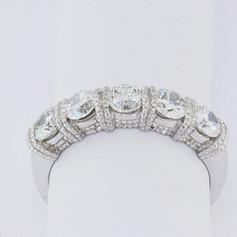 Platinum, 1.24ct total weight, hand miligrain, gem-lock set