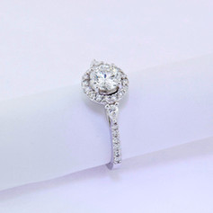 14k white gold, .45ct setting, .18ct pear shaped side stones, .86ct center stone round diamond engagement ring