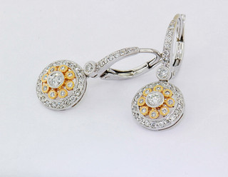 14k two-tone, white and rose gold .54ct total weight diamond earrings