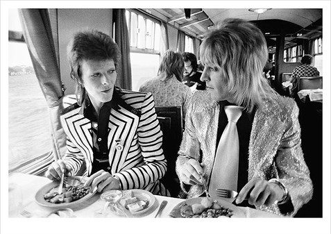 """David Bowie and Mick Ronson, Train to Aberdeen, Scotland 1973 © Mick Rock, 1973  11""""x14"""" $1,500 USD (limited edition of 90)  16""""x20"""" $2,500 USD (limited edition of 90)  20""""x24"""" $3,000 USD (limited edition of 50)  24""""x30"""" $4,700 USD (limited edition of 35)  30""""x40"""" $8,500 USD (limited edition of 25)  40""""x60"""" $15,000 USD (limited edition of 10)"""