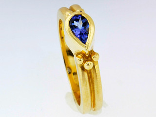 14k yellow gold ring with bezel set iolite center stone