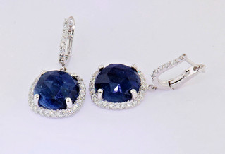14k white gold .84ct total weight diamond earrings with precious gemstone center stone