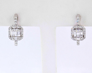 18k white gold .84ct total weight diamond earrings
