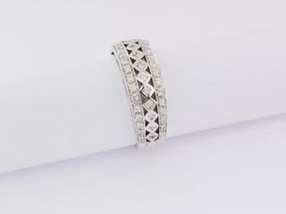14k white gold, .58ct total weight, pin point and burnish set, round diamonds